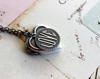 loves. heart locket necklace. silver ox jewelry