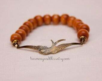 Bird charm bracelet, bird jewelry, bird bracelet, wood bead bracelet, wood beaded bracelet, stackable jewelry, bird charm jewelry