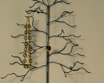 Handwelded recycled steel, wall-mounted tree for jewelry, holiday ornaments, or decoration. Made to order