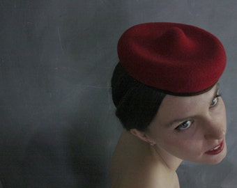 "Compact, elegant, sculptural red cocktail hat , ""The Amuse Tete no.10"""