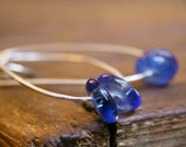 Oval organic hand forged sterling silver blue glass dangle earrings Seven jewelry