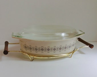 Pyrex promotional Empire Scroll Filigree casserole dish with lid and stand - vintage - 1960s