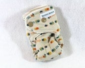 Final Clearance: Preemie / doll fitted cloth diaper / nappy made using bamboo / organic cotton, featuring bugs one beige.