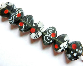 CRANE: CHARCOAL    7 charcoal gray, ivory, red and black matte finish zulus   A Beaded Gift