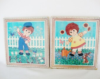 raggedy ann and andy gardening wall art