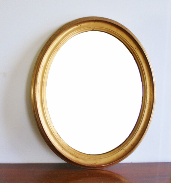 Vintage oval mirror with gold wood frame