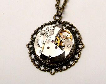 Steampunk jewelry. Steampunk vintage watch pendant necklace.