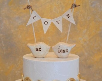 "Wedding cake topper and L O V E banner...package deal ... ""at last"" love birds and fabric banner included"