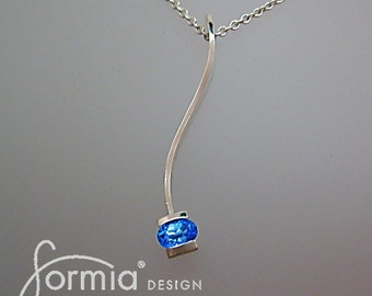 Genuine blue topaz set in simple modern pendant