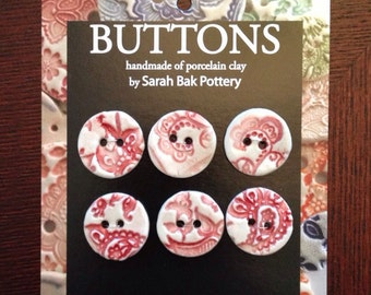 Red and white porcelain buttons, set of 6