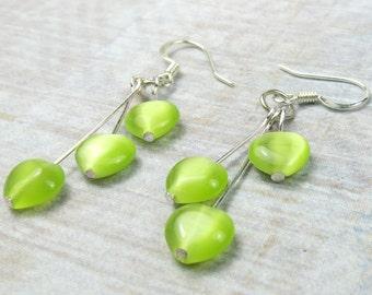 Neon Green cats eye heart earrings in triple dangle - green earrings - neon green - heart earrings, holiday earrings, plated silver