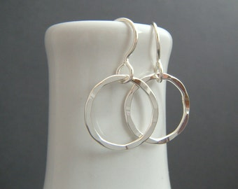 small silver hoop earrings. sterling silver textured circle dangles. tiny simple jewelry everyday earrings. drop hammered wavy wire. 5/8""