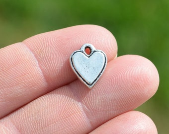 4  Silver Heart Charms SC2067