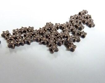 50 Itty bitty teenie wennie Copper spacer stars