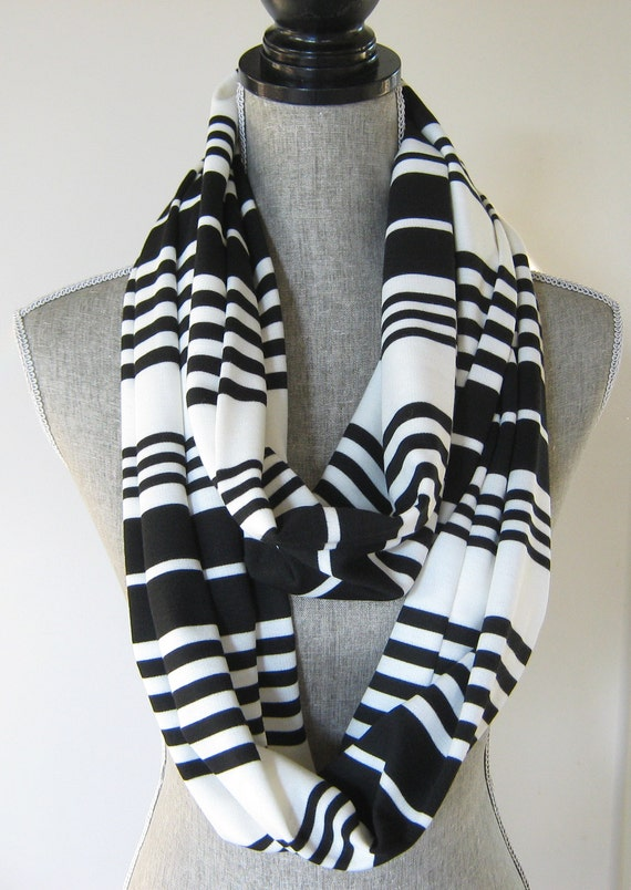 Municci Infinity Scarf Black White Striped New Go out in style wearing a very elegant soft infinity scarf. This scarf can be worn a few different ways.