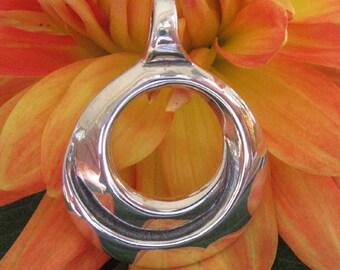 Compassion Pendant, Sterling Silver Symbolic Jewelry, Circle Pendant