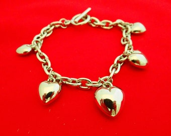 """Vintage silver tone 8"""" bracelet with puffy heart charms in great condition"""