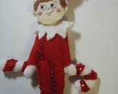 Bucilla Felt ELF sitting on a CANDY CANE from the Elf On The Self  Collection