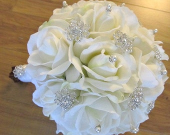 Wedding bouquet in real touch roses with rhinestone brooches and pearl accents
