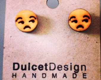Emoji indifference earrings
