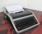 Vintage Olivetti Lettera DL 33 Typewriter Made in Barcelona Spain Sleek Black and Grey Styling