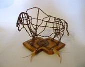 Buffalo sculpture made with recycled hay bale wire table top