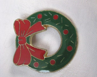 Festive green vintage enamel wreath pin brooch with red and gold accents