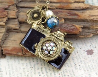 Take a picture. a camera necklace adorned with  pearl and crystal bead