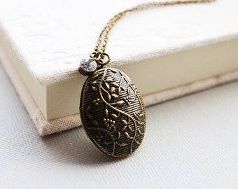 Oval Locket Necklace. floral motif oval locket in antique brass chain. everyday jewelry. graduation gift