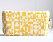 small cosmetic bag. yellow. geometric print. wet bag. waterproof. make up bag.