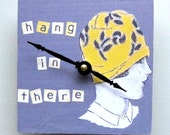Small wall clock with a message.  Clock for women. Hang in there.