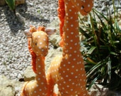 Mother and baby giraffe soft toys.  In soft orange cotton polka dot fabric.