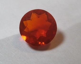 Natural  Hot Orange Red  Mexican  Opal  ....  faceted Round ....  9.7 mm round x 5.7  mm ..  a3378