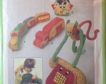 Vintage Sewing Pattern Colourful Stuffed Toys Retro 1970's Monkey Telephone Train Clock Truck Calico Cotton Uncut