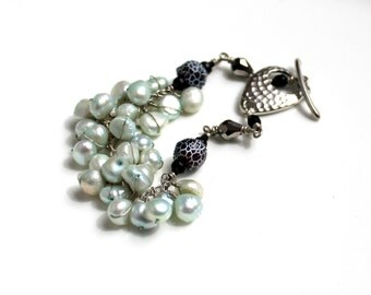 mint lava bracelet / light teal wire wrapped pearls / faceted grey glass