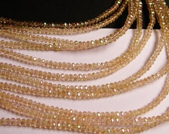 Crystal - rondelle  faceted 3mm x  2mm beads - 200 beads  - AA quality -light topaz color - ab finish - full strand - CAA2G45