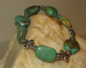 Turquoise Nugget Bracelet with Bali Silver Daisy Spacers & Silvertone Crosses Great Statement Piece