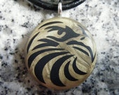 Eagle hand carved on a polymer clay Antique gold pearl color background. Pendant comes with a FREE Necklace