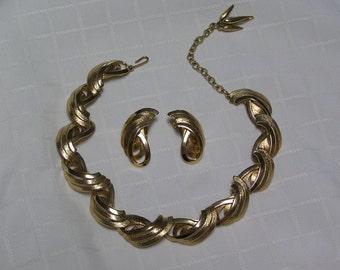 Vintage Hattie Carnegie gold tone swirl links..triple tassel finish..necklace and clip earrings