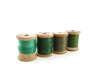 Green Wooden spools of thread, wood spools, sewing supplies