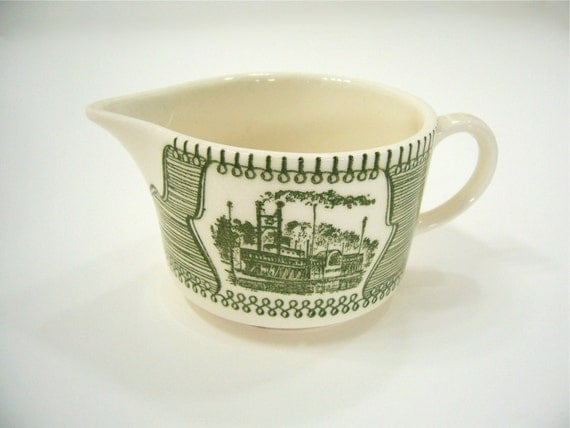 Vintage ceramic green steamboat transferware creamer pitcher serving kitchen housewares with triangular shaped logo, USA.