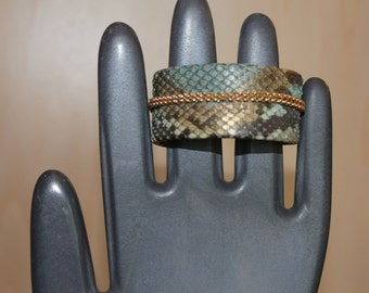 Lizard cuff with gold chain