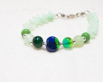 Green glass bracelet with silver spacers and lampwork bead center - Summer Leaves - Art Jewelry Seahawks colors pacific northwest green blue