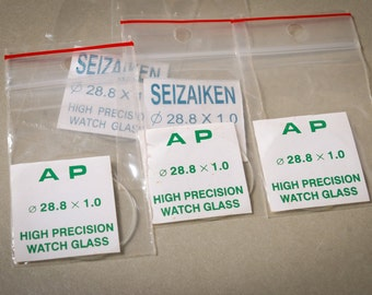 Set of 5 Seizaiken and AP watch parts, watch plastics, glass, crystal. Newer used,