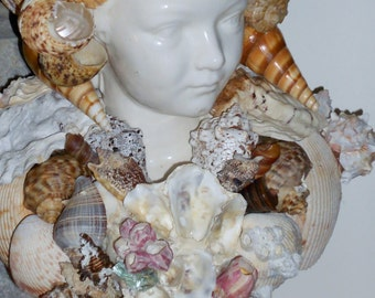 Handmade original bust of a boy with lot's of sea shells all over him