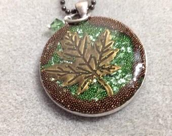 Dimensional maple leaf resin pendant