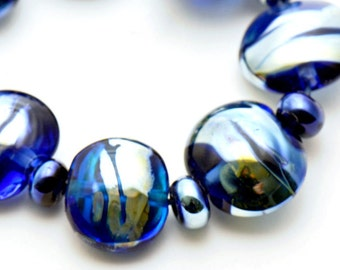 Triton on Blue Transparent Lampwork Beads Set of 17