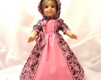 Bright pink on charcoal brown, long dress for 18 inch dolls, with bright pink inset and bright pink baby rick rack trim.