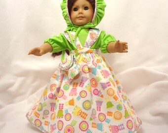 Five-piece Easter outfit, for 18 inch dolls.  Pastels on white with Spring Green.  Blouse, Jumper, Pantaloons, Bonnet, and Purse.