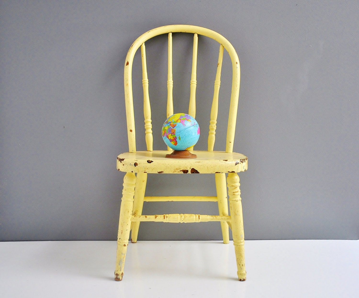 Vintage wooden child s chair spindle back yellow